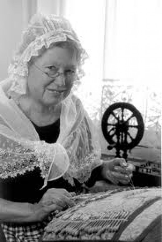 Madame is preparing some beautiful traditional Belgian lace patterns, a dying art.