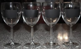 You can pick up a good wine glass from most Dollar stores these days