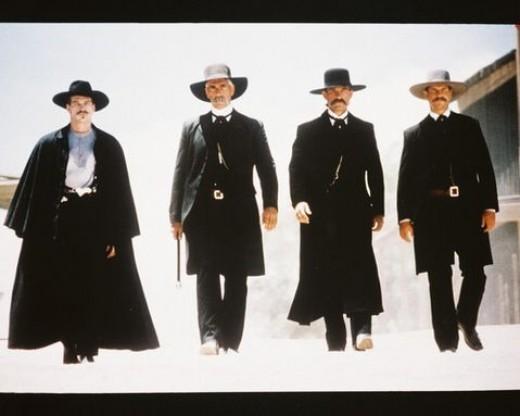 "Val Kilmer as Doc Holliday, Sam Elliot as Virgil Earp, Kurt Russell as Wyatt Earp, and Bill Paxton as Morgan Earp in ""Tombstone"" (1993)"