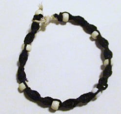 Black hemp spiral men's hemp bracelet with plastic large holed beads.