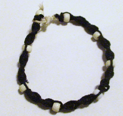 Black hemp spiral men's hemp bracelet with plastic large holed beads.