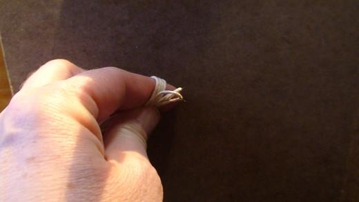 Step 4.1  Beginning the overhand knot.