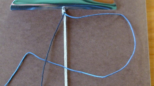 Step 4  Left cord (black) is overtop of right cord (blue.