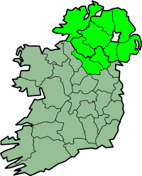 Map of the entire island of Ireland. The counties are indicated by thin black lines, the traditional Province of Ulster by bright green, and the modern territory of Northern Ireland indicated by a heavy black border across the island that separates.