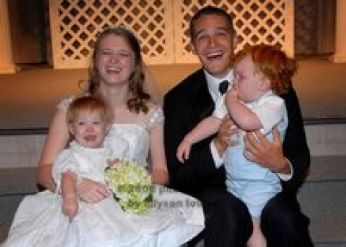 Shanna holding Maggie and Bryant holding Granger at Shanna's wedding.