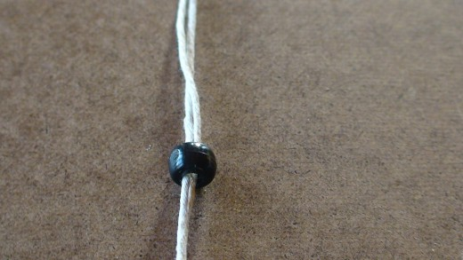 Step 1-2  String large bead on two anchor cords.
