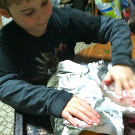 Wrap the aluminum foil around the beets and place in an oven preheated to 450°