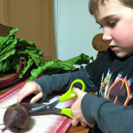 Using kitchen scissors, cut the stems of the beets. Tip: don't cut too close to the beet or the color will bleed.