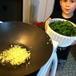 Heat a little olive oil & add some minced garlic to wok or large pan on stove top over medium heat.
