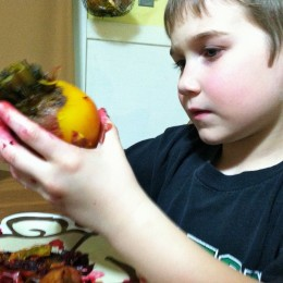 Peeling beets is an easy task for children to help with in the kitchen.