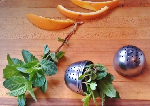 I love fresh mint for tea.  Just crush it up and put it in a tea egg or strainer, and pour on the boiling water, or simply put the crushed leaves directly in your tea pot or cup and strain before drinking.  Delicious with orange peel!