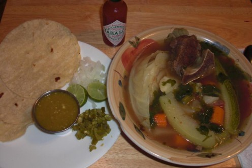 My homemade Caldo de Res served with Mexican rice, hot corn tortillas, chopped jalapeno, onions, limes and salsa or chile.