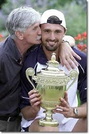 Chip off the old block!  Dad Srđan gives Goran a kiss after winning at Wimbledon.