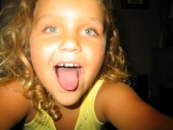 This pic is Brianna at 8. She is being goofy and taking pics of herself.