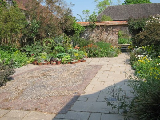 A hardscape garden makes an ideal setting for potted vegetables.
