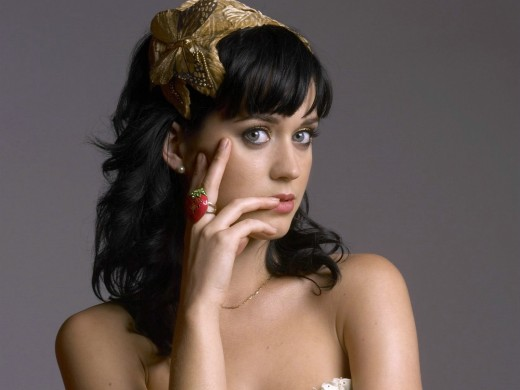 Katy Perry with another finger in her mouth