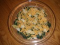 Sharp cheddar on top of the artichoke hearts and spinach.