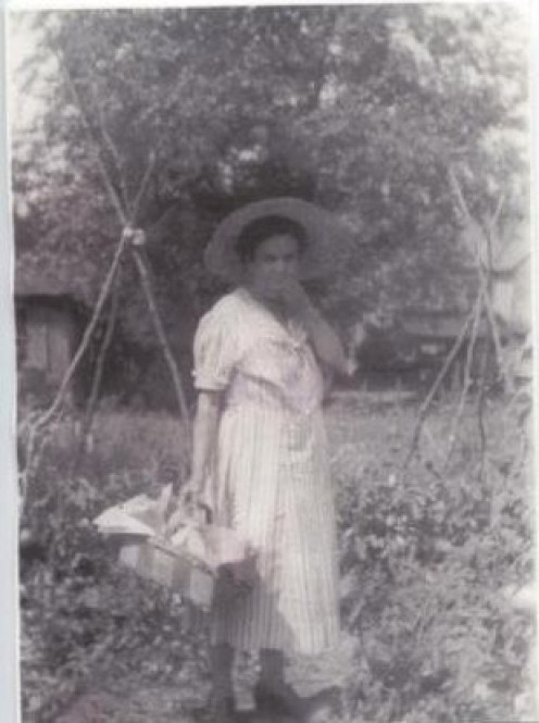 My great-grandmother working in the garden