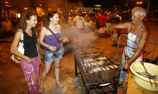 Open air fish barbecued on hot coals, in the warm summer evenings is typical of life in Summertime Dalmatia