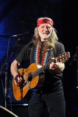 Willie Nelson performing at Farm Aid in 2009, one of the many charitable causes he has been involved in over the years.