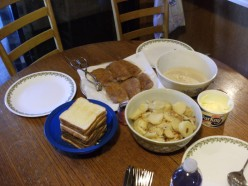 The complete set up Deep fried Pork Chops, Skillet Potatoes, Home made gravy,and Toast.