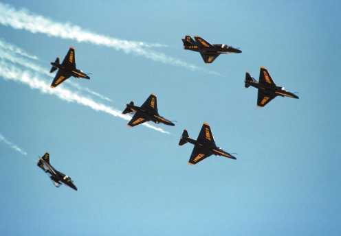 "A-4F Skyhawk Blue Angels flight demo team execute a ""Fleur-de-Lis."""