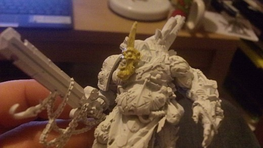 Start by painting a light color for the head. A Bronzed flesh works quite well.