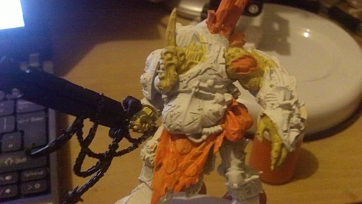 Hobgoblin orange is used to paint the ragged tunic.