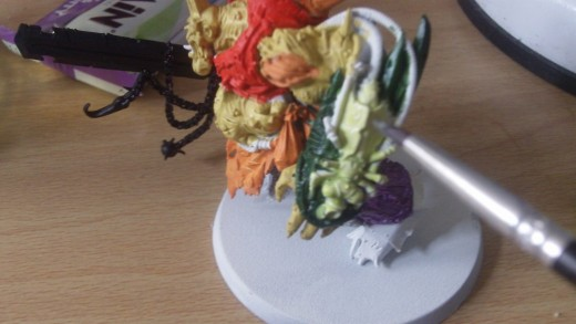Bilious green which is a lighter green for the rotting fly nurgle symbol on the arm.