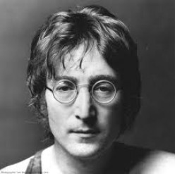JOHN LENNON LOOKING DEPRESSED. GUESS WEARING FAKE EYEGLASSES CAN DO THAT TO EVEN THE MOST CREATIVE MUSICAL GENIUS, HUH?