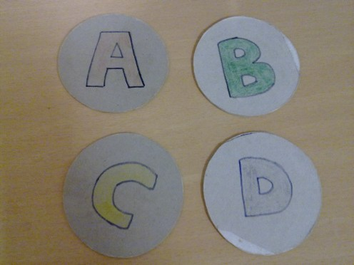 Use marker to draw the alphabets and color them