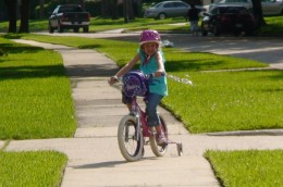 Younger kids riding on sidewalks should also be aware of pedestrians and other children playing in their yards.