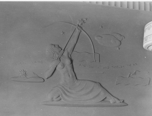 "FWA:PBA:Paintings & Sculptures for Public Buildings: bas relief of classical woman archer with words ""Over land and sea and through the air."" Artist Elliot Means; Suffern New York"