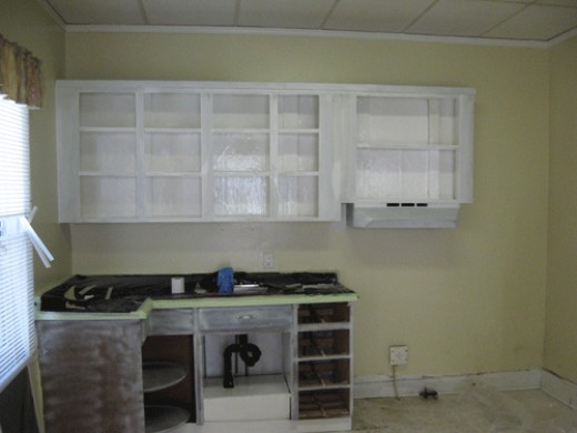 Here you see the upper cupboards painted inside and out for two coats. The lower cupboards have a mist coat on them.