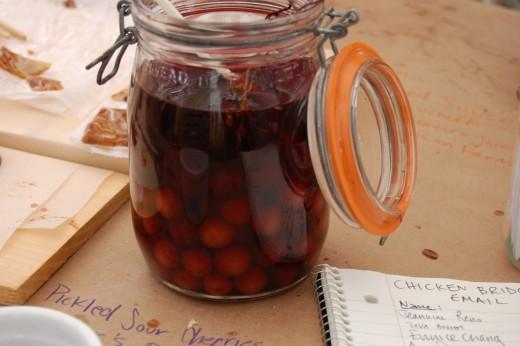 Pickled Cherries in a jar.