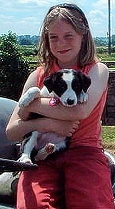 a younger Kate with Gin as a pup