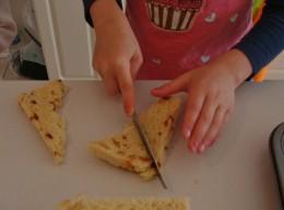 Cut the sliced bread into smaller pieces.