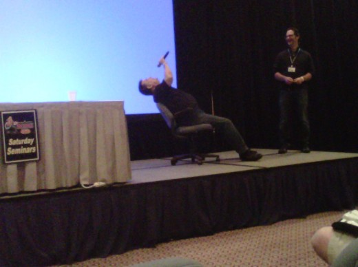 Steve Ritchie hypnotizing the audience at the Texas Pinball Festival.  We all went out and bought an AC/DC pin.