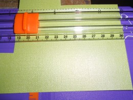 Use paper cutter for straight edges and to ensure even shape.  Then trim edges with verigated scissors if desired.