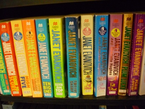 My bookshelf containing the books next on my reading list:  More Janet Evanovich novels.