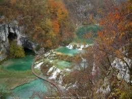 With less crowds in the Fall, there is plenty of time to linger and take plenty of photographs.  The colorful autumn leaves make a rustic contrast to the fresh flowing aqua colored water.
