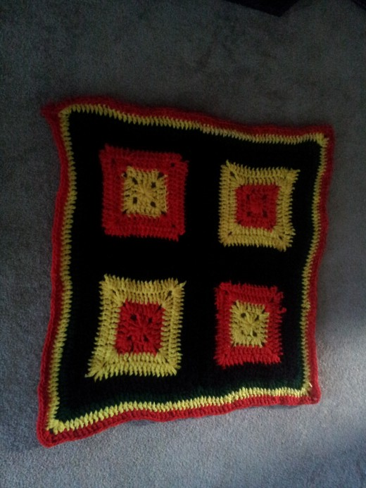 solid granny square afghan