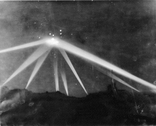In this dramatic photo of the mysterious light in the skies over LA, one can see the search lights engaging it and flak exploding near the light. The height of war panic caused this response to cosmic lights. No scrap was ever found.