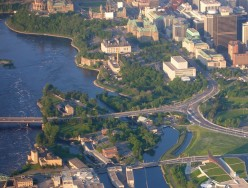 Victoria island (bottom) in the Ottawa River, connected by bridge to City of Ottawa near Parliament hill (top)