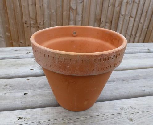 A terracotta wall hanging pot