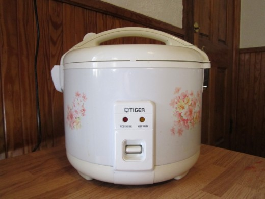 Rice Cookers are a great tool to have in the kitchen! While the rice cooks itself at the push of a button, you can be doing other things in the kitchen! Rice stays perfectly hot and moist for days when made in a rice cooker!