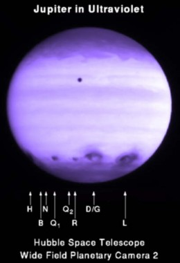 This is what Jupiter looked like in ultraviolet after a fragmented comet, Shoemaker-Levy 9, slammed into it in 1994. Many of those scars are larger than Earth. This is why blowing up an asteroid may not be the best approach.
