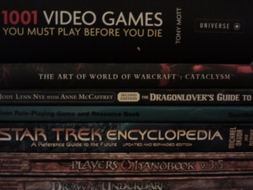 Just a small sample of my collection- including D&D 3.5, WoW Cataclysm, Star Trek and Pern, Sailor Moon, and of course, 1001 Video Games You Must Play Before You Die