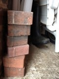 Bricks and boots in the storeroom.