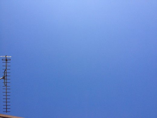 The bright blue sky.